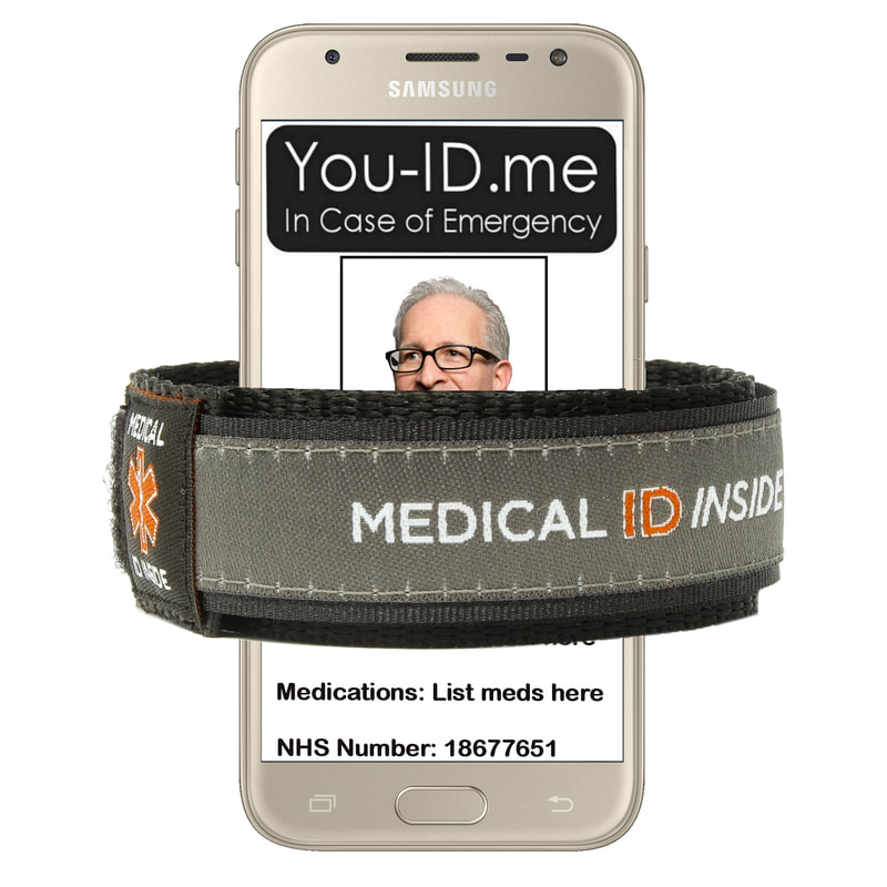 Grey medical alert bracelet shown with mobile phone